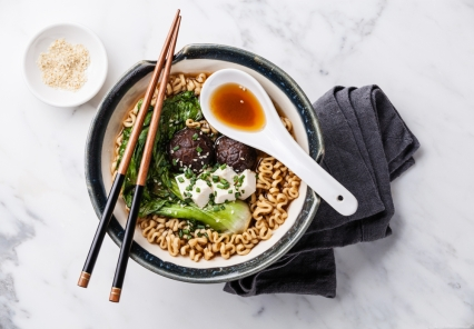 Miso Ramen Asian noodles with shiitake, tofu and cabbage pak choi in bowl on white marble background